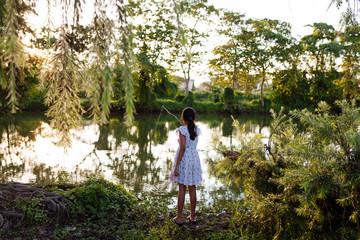 A teenage girl enjoying fishing activity