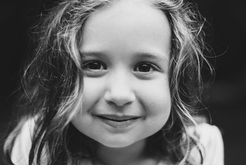 Close up portrait of a beautiful young girl in black and white
