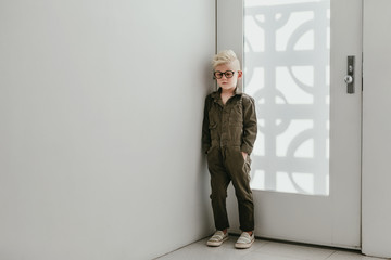 Boy leaning on door at home Wall mural