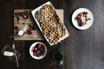 layout of waffles and ingredients on wood table