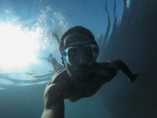 Underwater portrait of young man snorkeling