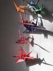 Japanese origami cranes hanging in bedroom