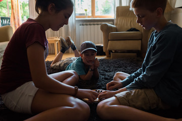 children playing a game at home