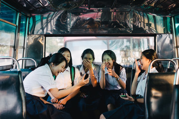 High school students in uniform on the bus in Bangkok