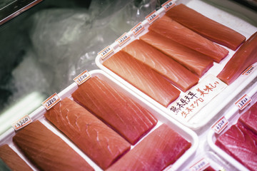 Small pieces of filleted tuna with  Japanese price tags
