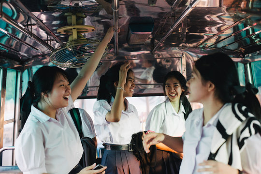 Teenage students in bus after the school