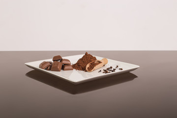 Chocolate with cinnamon and cloves on the glass table