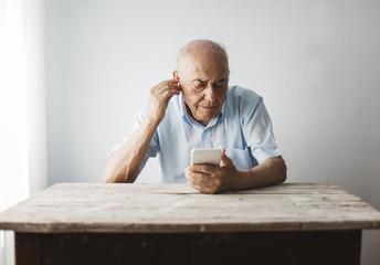 Senior man listening music