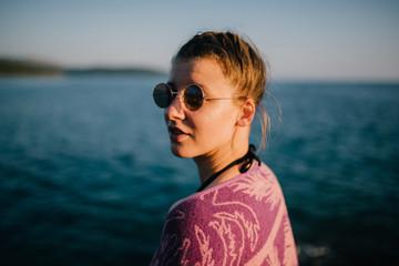 Young woman enjoying sun near the sea