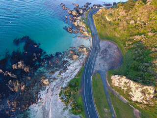 Looking down on winding coastal roads in New Zealand