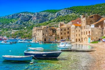 KOmiza seascape Island Vis. / Seafront scenic view at Komiza summer scenery in South of Croatia, mediterranean travel places.