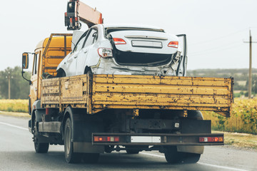 Tow truck transport smashed car after traffic accident