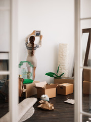 Woman moving into new apartment