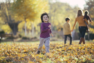 Happy child running in park.