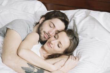 Couple sleeping hugging on pillow