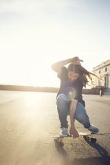 Man riding skateboard in evening