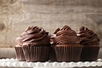 Chocolate cupcakes on white cake stand