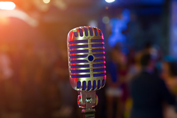 Wedding meeting and event on stage concept - Close up retro microphone. on stage of business meeting or event whit flare light effect and copyspace