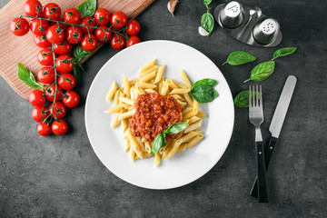 Plate of delicious pasta with bolognese sauce on table
