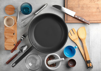 Composition with kitchen utensils on grey background