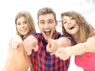 closeup of three happy young people showing hands forward