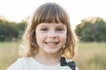 Young Girl smiles At The Camera