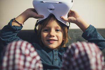 Portrait of Boy Holding 3D Gear Glasses