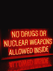 No Drugs or Nuclear Weapons Allowed Inside neon sign
