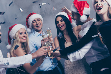 Close up of cute festive youth with stemware of martini on luxury feast, glitters is in air, newyear is here! Classy outfits, so glamorous and fancy! Chilling, funky mood, dance all night long!