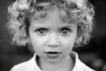 Intense Portrait Of Blonde Curly Haired Toddler