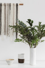 Modern decor and vase of greenery