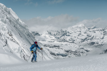 Skier going up with ski touring in the Italian alps