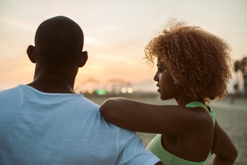 Young attractive black couple at the beach at sunset