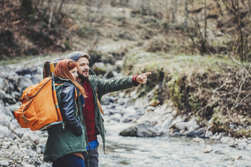 Couple Hiking With a Backpack