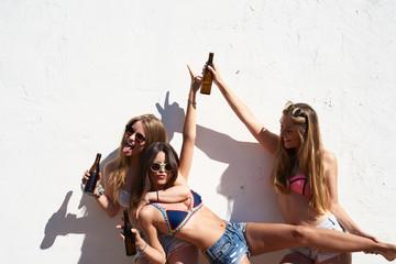 Three girlfriends having fun and fooling around
