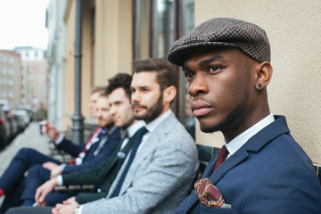 Handsome Young Black Man Sitting with Friends in Cafe