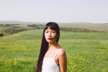 Beautiful Asian young woman enjoying summertime in the nature