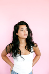Attractive young woman with pink background