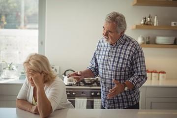 Senior couple arguing in kitchen