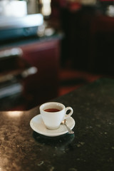 Tiny White Coffee Cup with Espresso Coffe in a Coffee Shop
