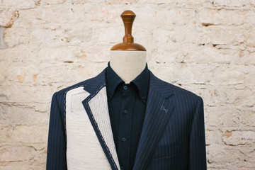 Close Up of Expensive Blue Pinstripe Suit on Hanger Stand