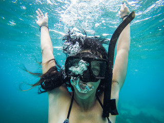 Woman Underwater in Snorkel Mask with Bubbles