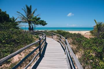 Wooden walkway leading to beautiful beach in Brazil