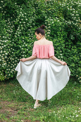 Portrait of a female model in beautiful skirt from back