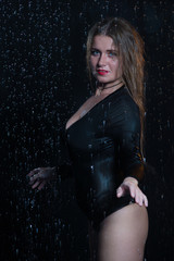 Sexy beautiful woman under rain