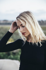 Beautiful blonde female wearing black