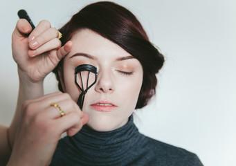 Beautiful woman in her twenties having make up applied