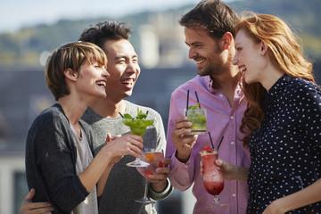 Happy Friends Enjoying Cocktails