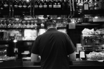A back portrait of a man in the bar