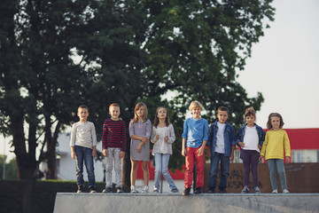 Group of Kids Standing Outdoors